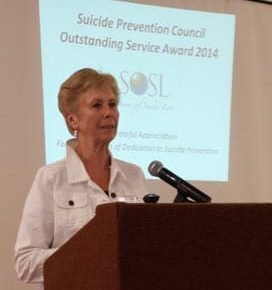 Bonnie accepting the award on behalf of SOSL.