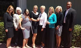 From left, Elizabeth Vaughan, Carol Skiljan, Yeni Palamino, Jenni Morel, Bonnie Bear, Leah Rodig, Beth Sise, and Dana Richards. The leaders of the Suicide Prevention council photographed with Jenni and Bonnie of SOSL, and Leah Rodig of AdEase, who won the award for Outstanding Partner.