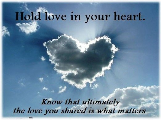 photo finding peace through heart shaped cloud writing over hold love in your heart